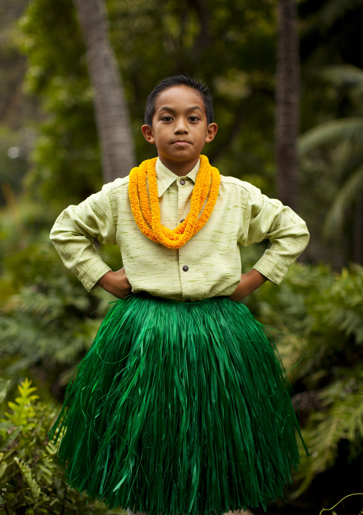 Boy in hula attire and lei