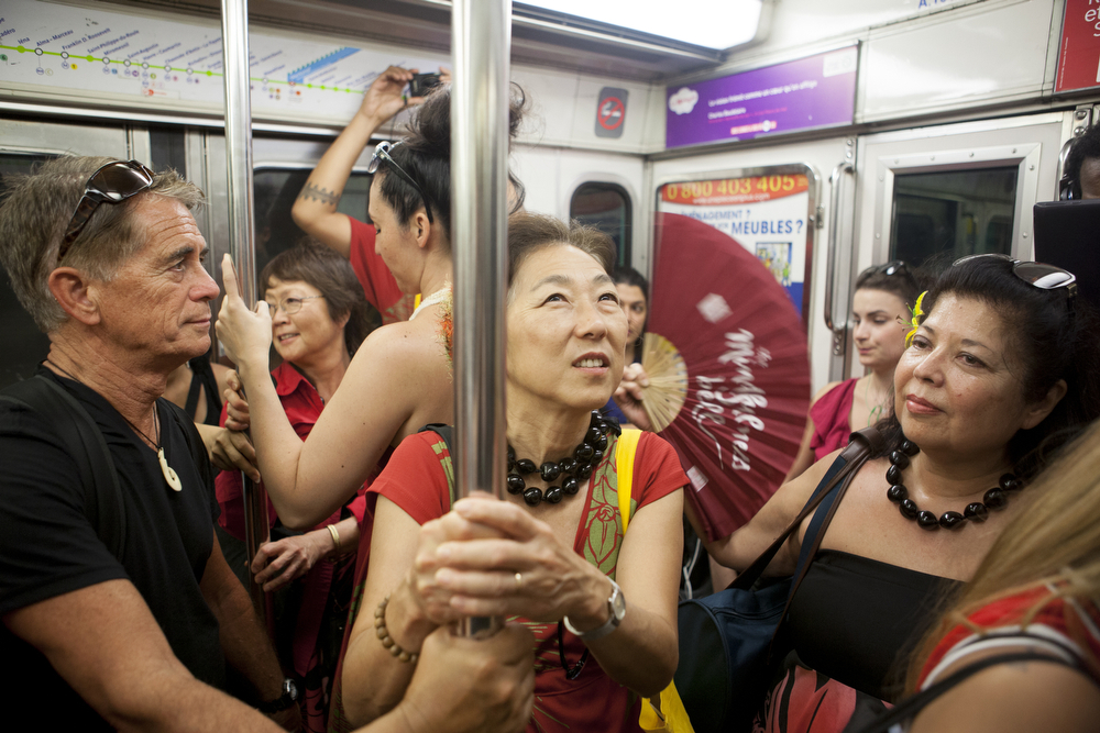 Participants in the Festival des Arts d'Hawai'i ride the Paris subway
