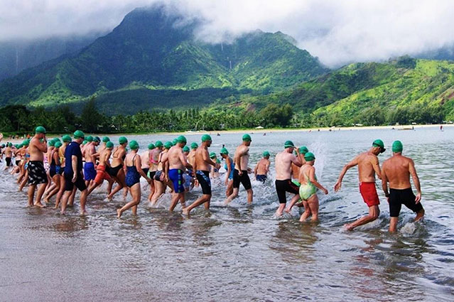 swimmers entering hanalei bay