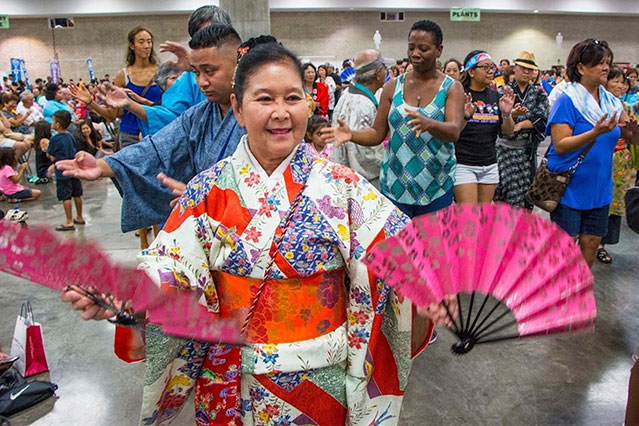 dancer in kimono with fans