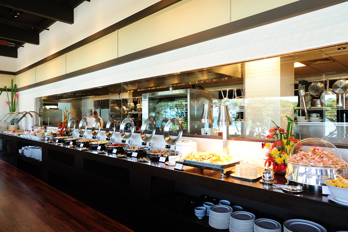 Buffet line offers a view of the kitchen where cooks busily prepare delectable dishes.