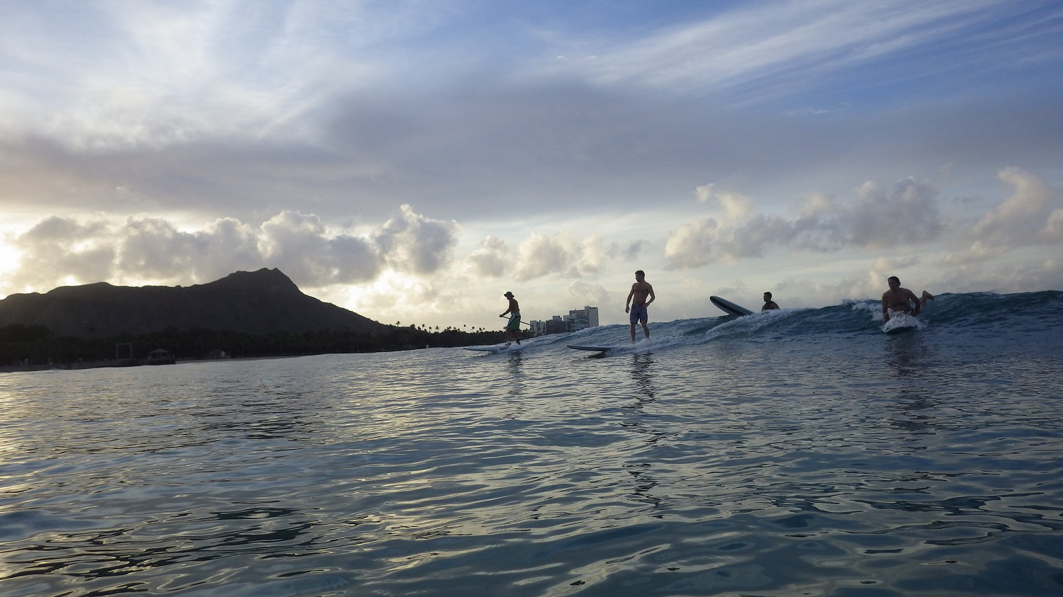 Surfers at dawn